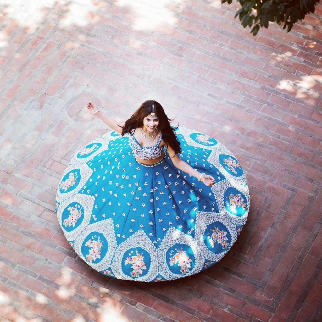 twirling in blue lehenga