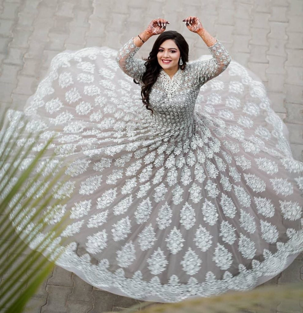 twirling in white lehenga