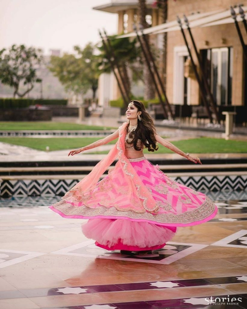 twirling in pink lehenga