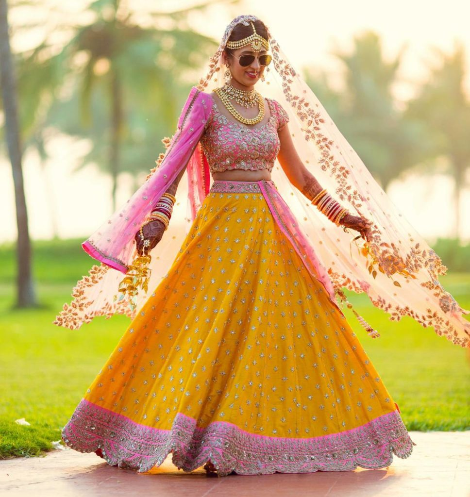 twirling in yellow lehenga
