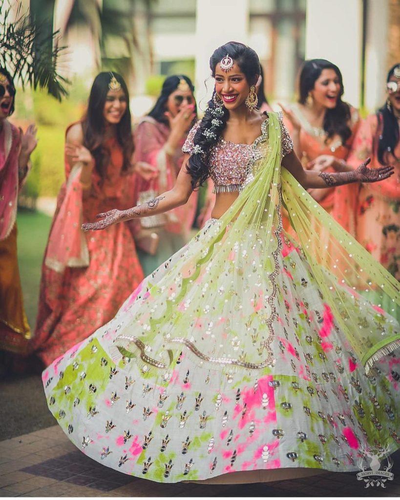twirling in colourful lehenga