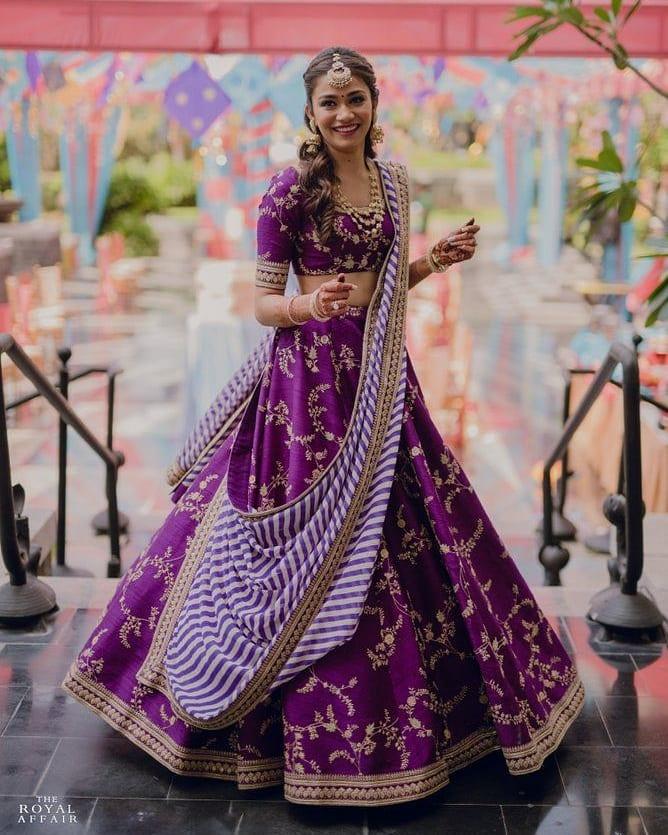 twirling in purple lehenga