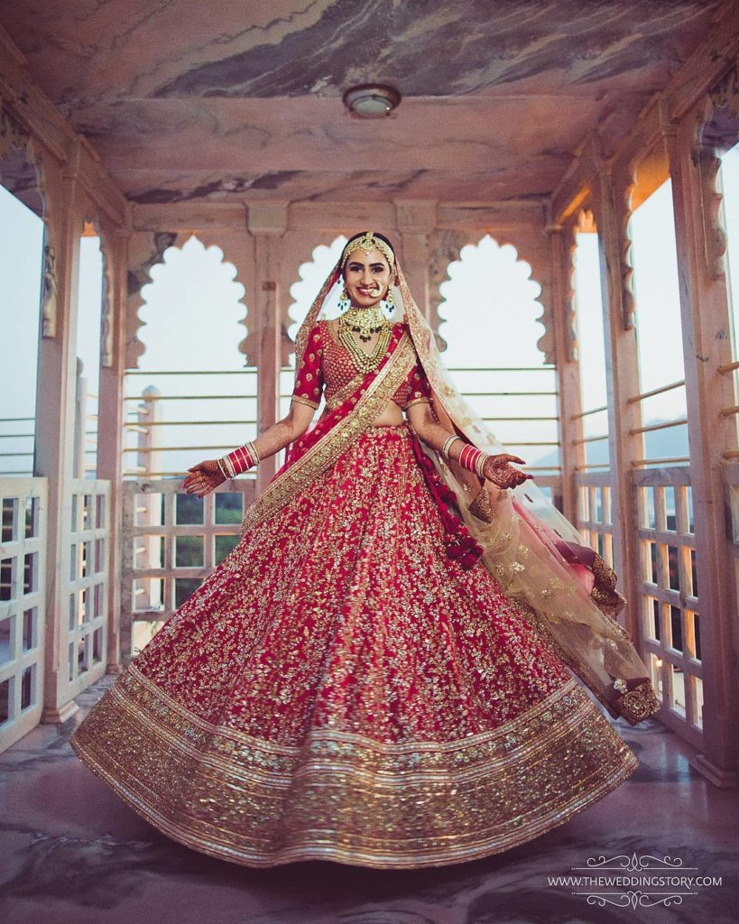 twirling in red lehenga