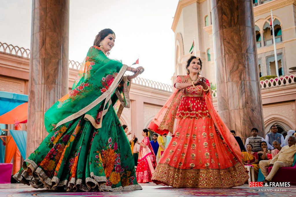 a view of the candid wedding photography at mehendi ceremony in Abu dhabu wedding