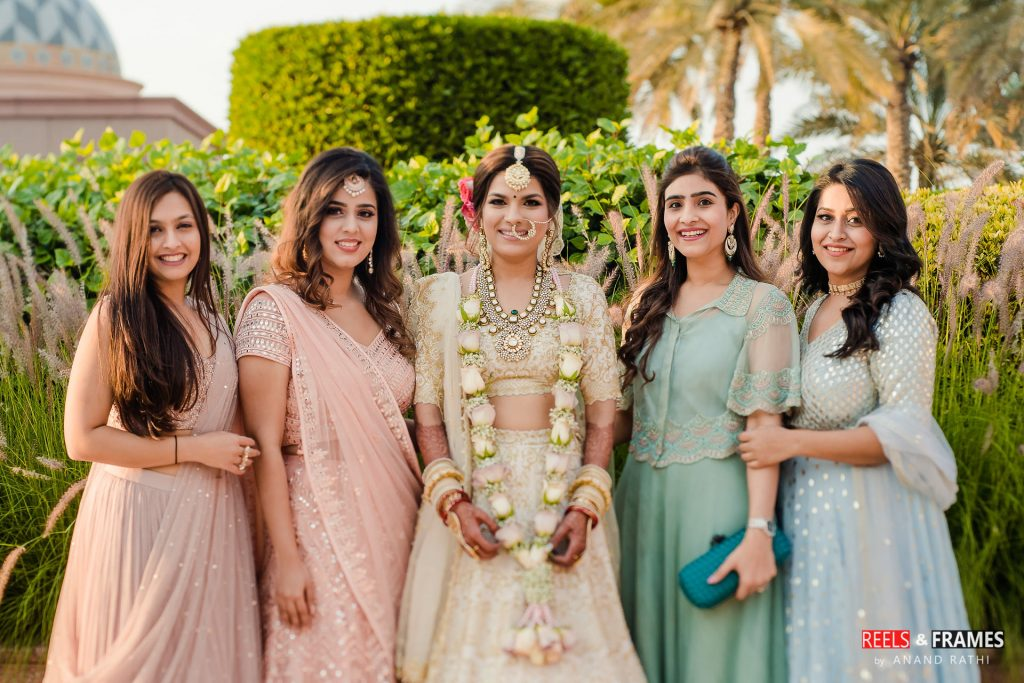 Color coordinated outfits of bridesmaids in Abu Dhabi wedding.