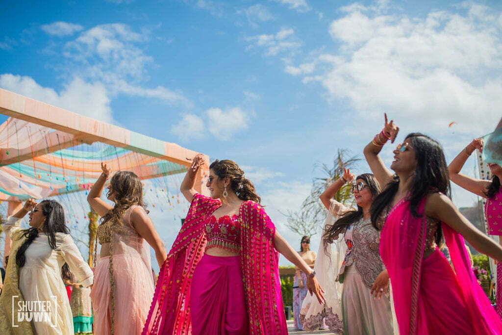 Bride for her bridal mehendi in a hot pink outfit at this bali wedding