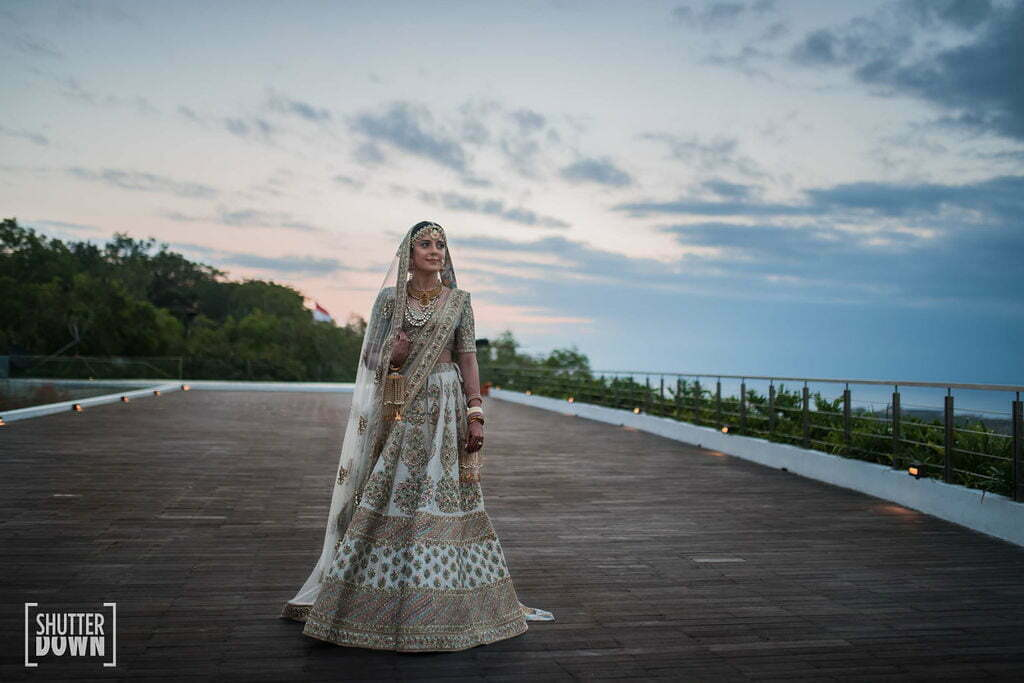 bride in a sabyasachi outfit for her destination bali wedding