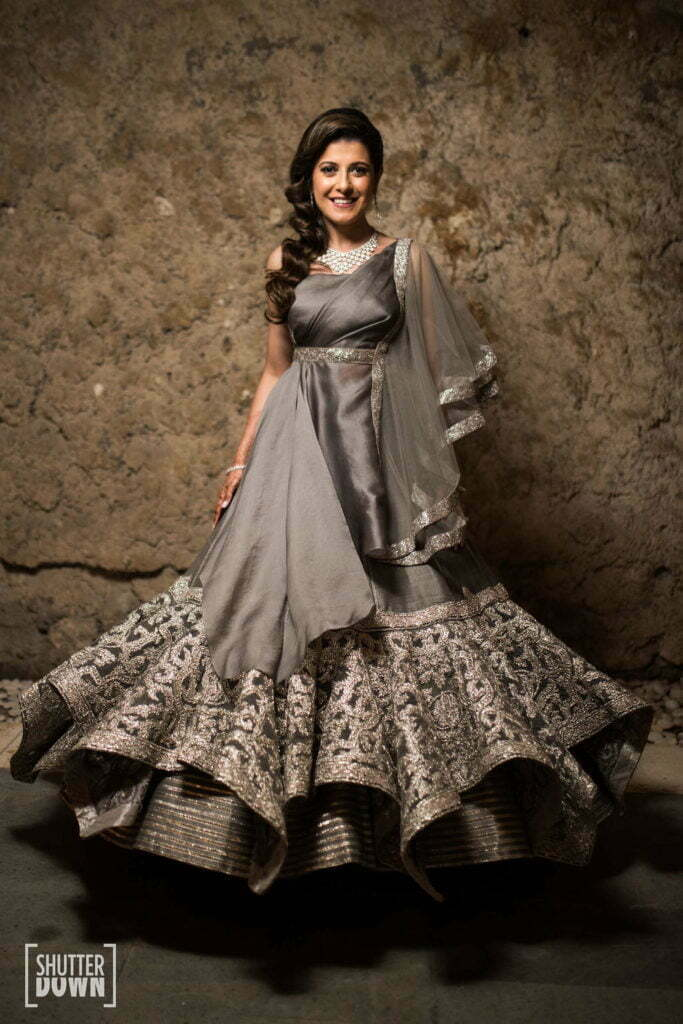 a grey gown for the bride by Shantanu and nikhil at a bali wedding