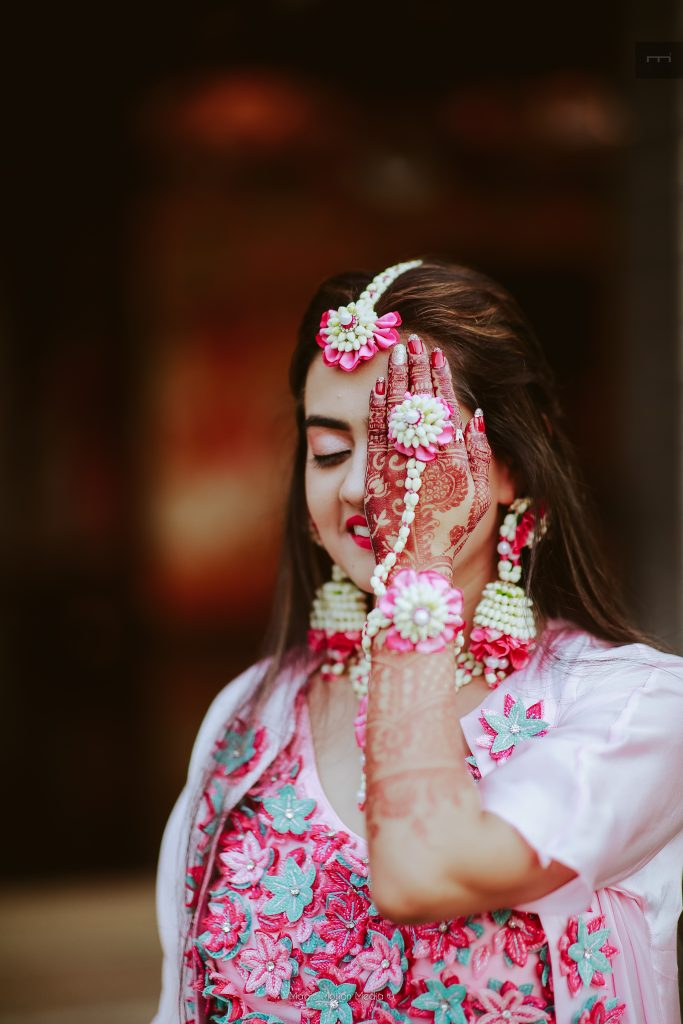 beautiful floral jewelery of the bride on bridal mehendi ceremony